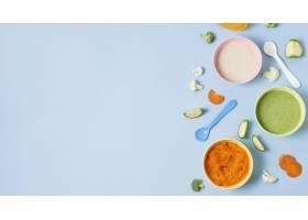 在蓝色背景的婴孩食物框架_8805120