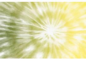 在黄色背景的柔和的漩涡领带染料_15474260