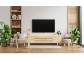 在白色墙壁上的电视内阁在有扶手椅子的客厅_15832324