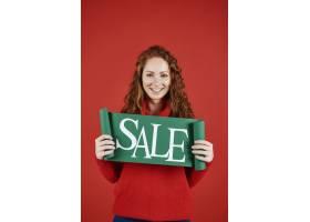 显示冬天销售横幅的女孩画象_11821555