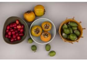 橙色柿子果子顶视图在一个碗的有feijoas的_13667049