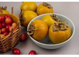 新鲜的柿子果子顶视图在一个碗的用在一个桶_13803894