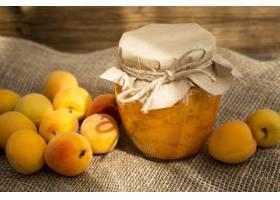 杏子的安排在布料的与瓶子蜜饯_9851348