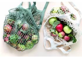 新鲜的苹果在购物袋滤网零废物没有塑料_9764778